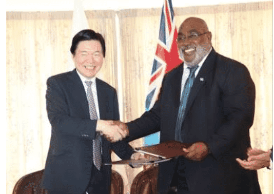 Japanese Ambassador to Fiji, Masahiro Omura. (left) and Fiji's Minister for Fisheries, Semi Koroilavesau, seal the deal