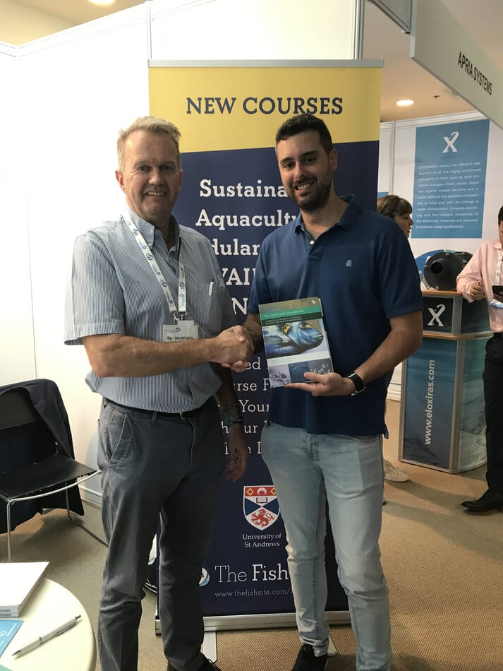Francisco collects his copy of Sea Bass and Sea Bream: a practical approach to disease control and health management from Nigel Balmforth of 5m Publishing.
