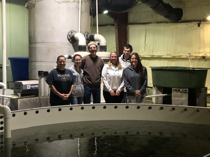 The team at Mic Mac Farms, which produces 5 tonnes of brook trout a year
