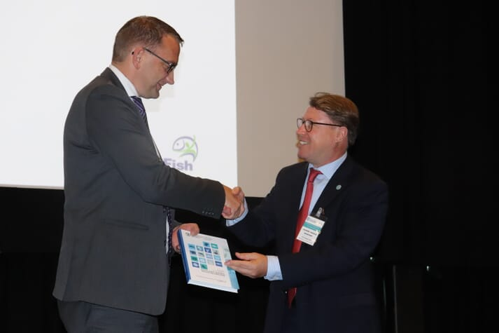Roy Angelvik, Norway's state secretary for the minister of fisheries, and FAO's Matthias Halwart officially launch the report