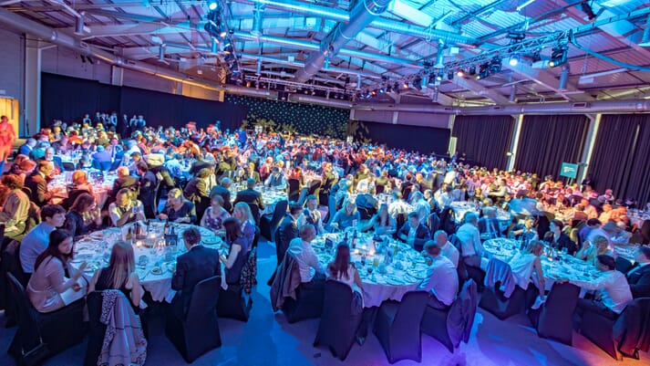 Conference delegates seated for a formal dinner
