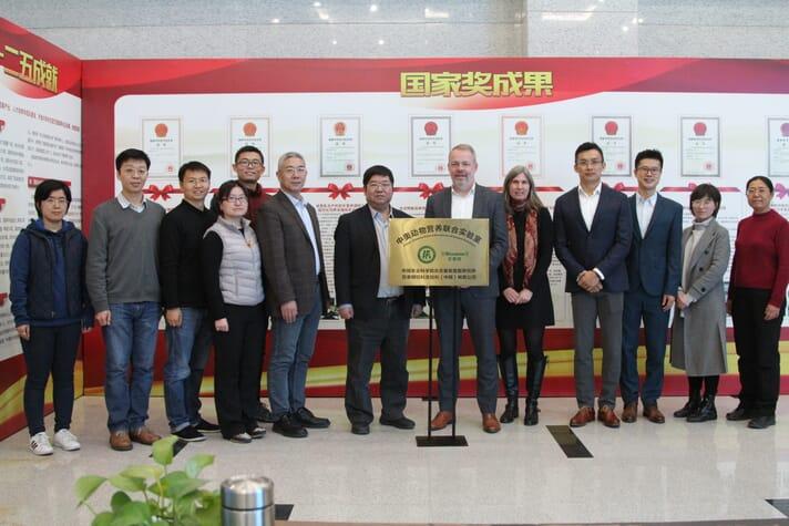 Pictured left to right: Yi Bao, Ma Teng, Chen Liang, Zhou Lingyun, Zhong Ruqing, Kong Pingtao, Zhang Hongfu, Jan Vanbrabant, Gudrun Vogtentanz, Jack An, Shu Guan, Nina Hao, Sa Renna