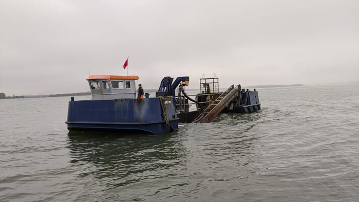 Othneil Oysters' oyster barge at work in Poole Harbour