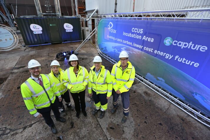 Drax Group CEO Will Gardiner (second right) accompanied Energy and Clean Growth Minister Claire Perry in a visit to the Drax Power Station BECCS pilot project in November 2018