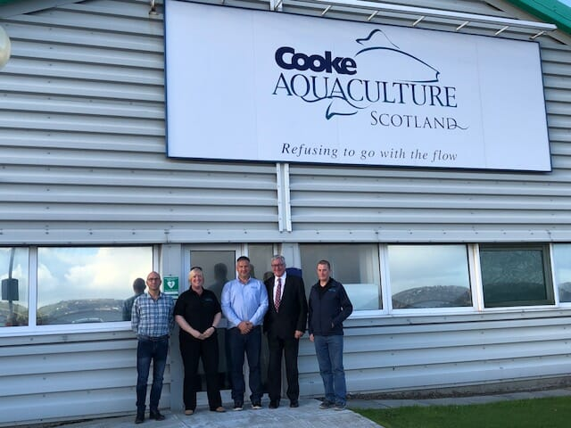 Cooke Aquaculture's Christopher Webb, Vicci Laird, Stewart Rendall and Robert Peterson with Fergus Ewing