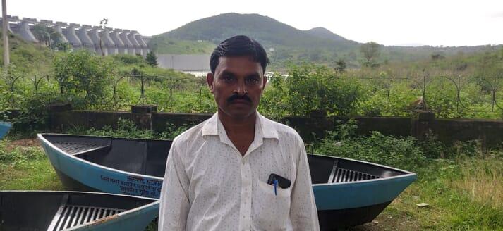 Fish farmer Arjun Kewat, in front of the Chandil Dam