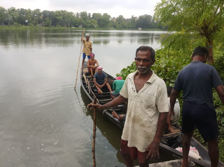 Bijay Mondal earns a living farming fish and then catching them in the East Kolkata Wetlands