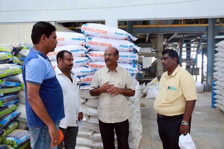 M Karuna Raju of Sai Aqua Feeds beside the company's Vannamei Plus shrimp feeds