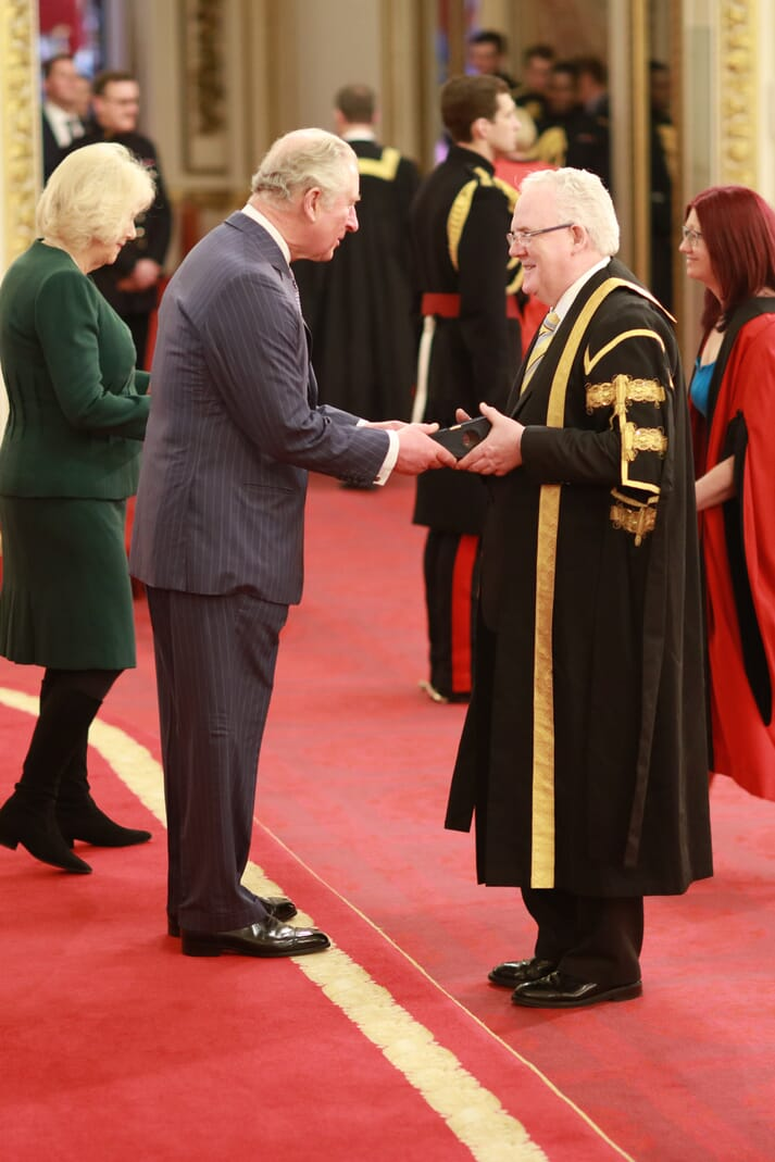 Prof Gerry McCormac and Prof Selina Stead receive the award from the Duke and Duchess of Cornwall