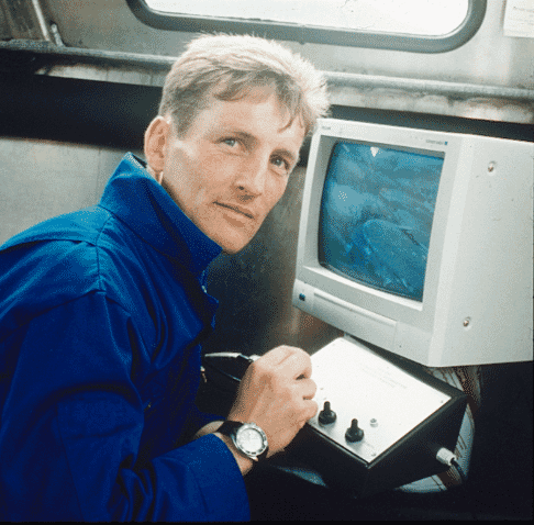 Man sitting at a computer from the early 1990s
