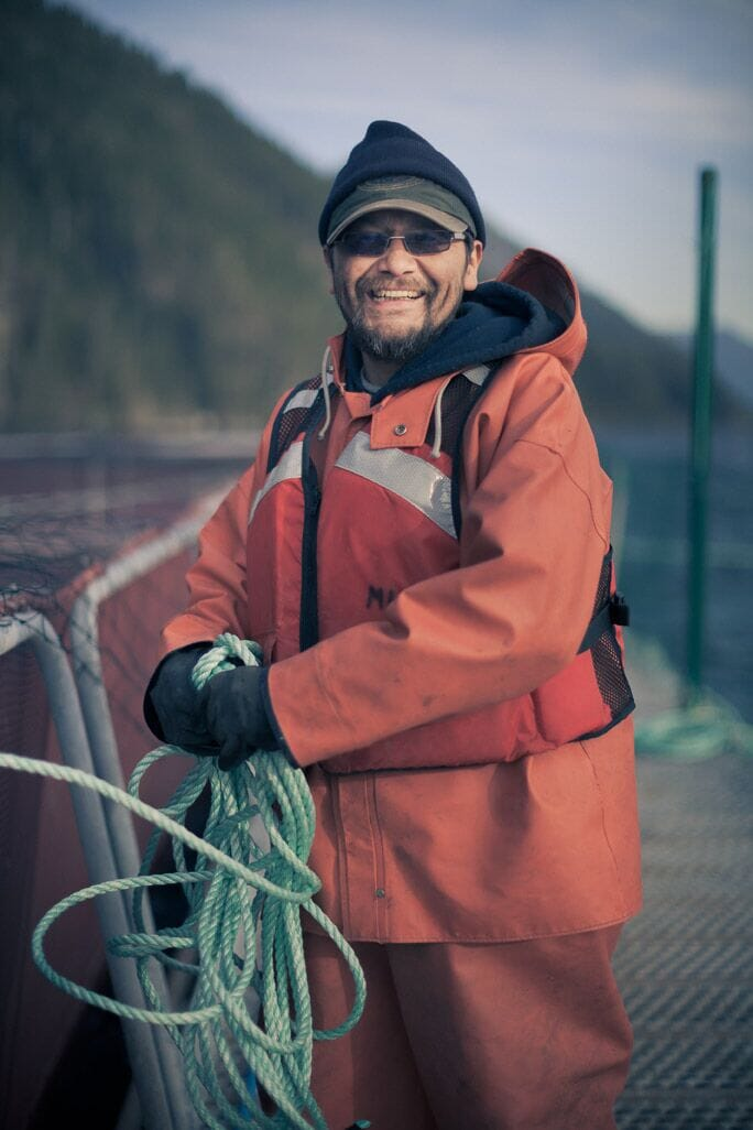 Aquaculture technician Rudy Dick on a salmon farm in traditional Mowachaht Muchalaht territory, Nootka Sound
