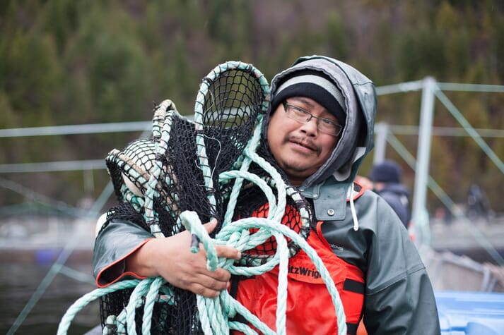 Aquaculture technician Tim Johnson working on Grieg Seafood BC's Nootka Sound farms in traditional Mowachaht Muchalaht territory off the west coast of Vancouver Island