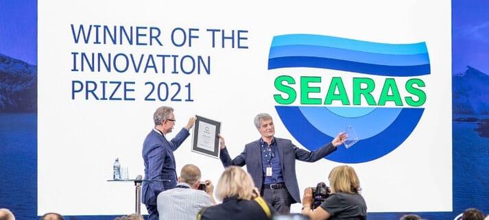 Norway's Fisheries Minister, Odd Emil Ingebrigtsen (left), presents the Innovation Award to SeaRAS CEO, Eldar Lien