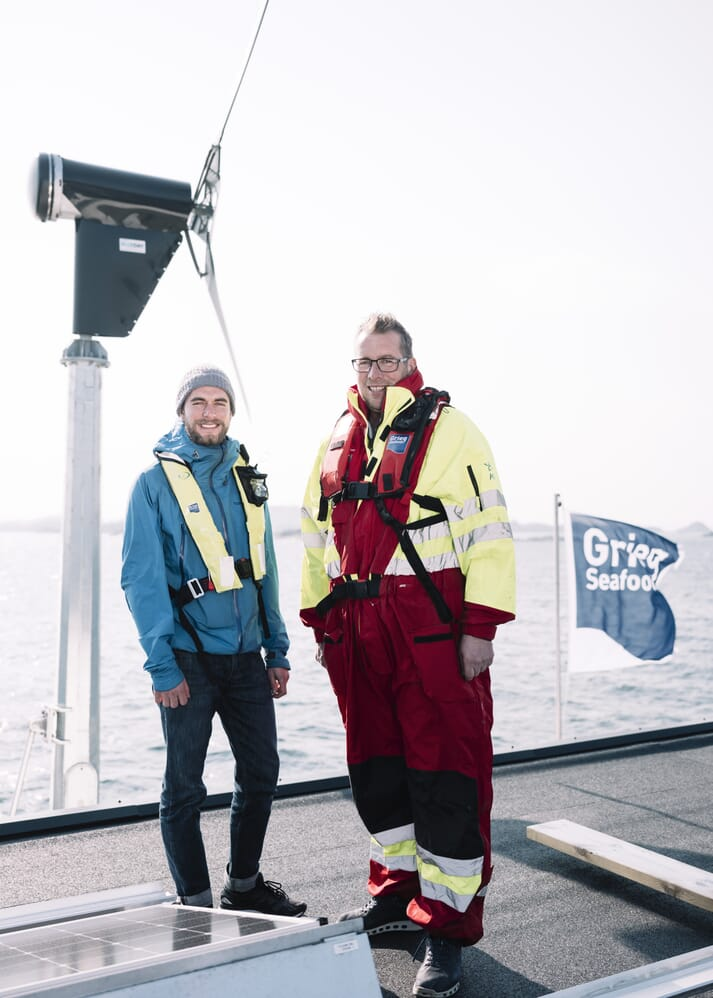 Helleik Syse (left) and Kjetil Ørnes (Grieg Seafood Rogaland production manager) (right) with the wind turbine