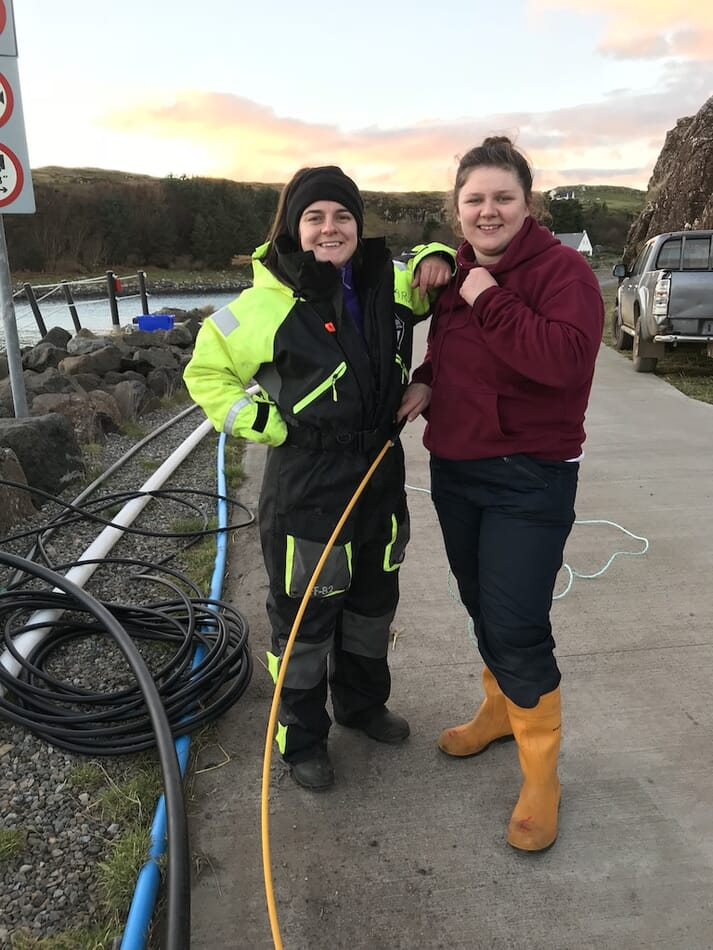 Clara on site with Emily Connoly, who works as an apprentice electrical engineer for Mowi