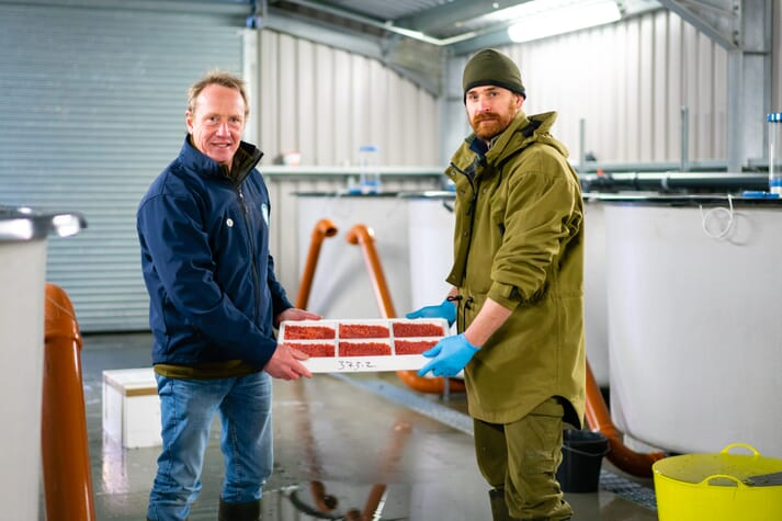 Henry Dalgety head of broodstock at The Scottish Salmon Company, hands over the over to Andrew Gorthy of Benmore Estate