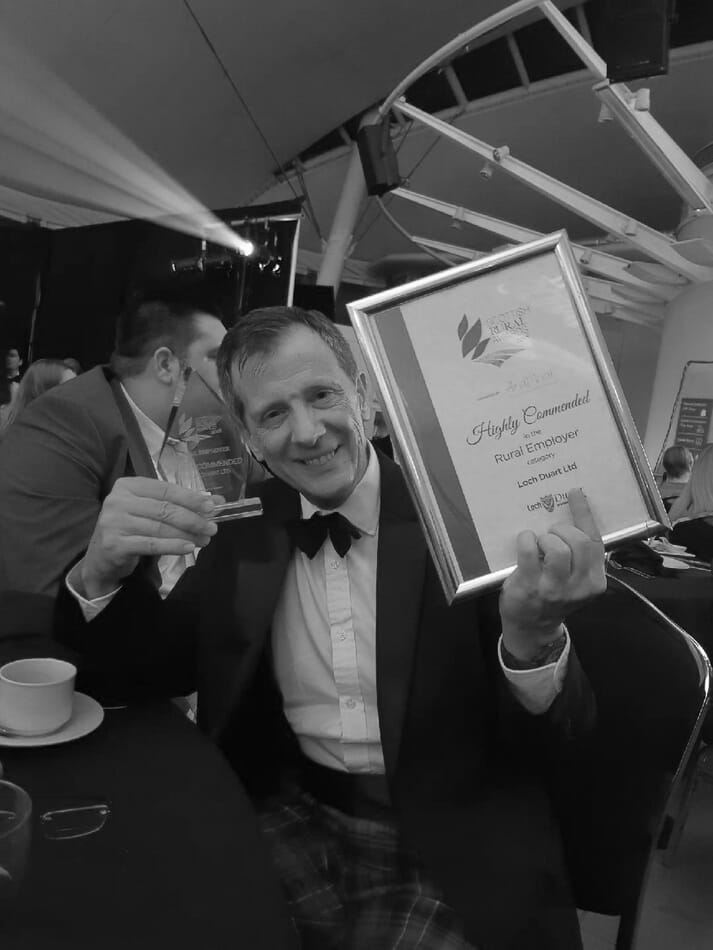 Loch Duart's sales director, Andy Bing, collects the award