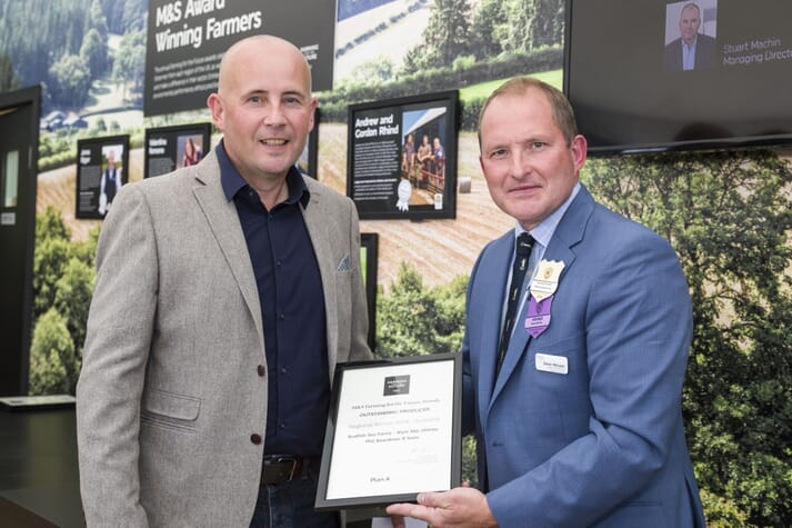 Richard Derbyshire, area manager at Scottish Sea Farms on Orkney receives the award from Steve McLean, Head of Agriculture & Fisheries Sourcing at M&S