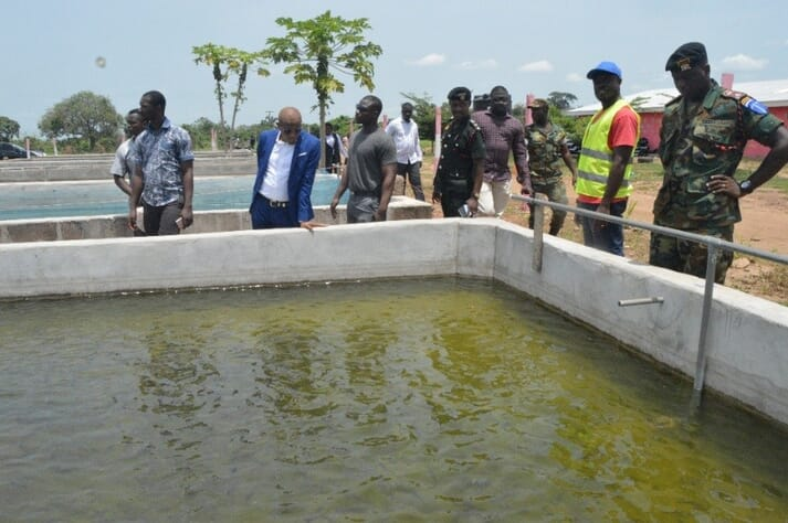 Capt. Frimpong (in uniform, 6th from Left) with Ghana's Minister of Information, Mustapha Hamid, at one of the ponds