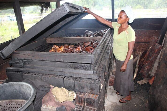 Immaculeta Ufa operating a Chorkor oven