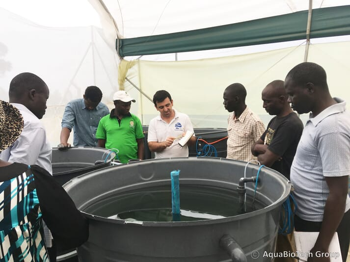 Julian Mamo (centre) engineer at the AquaBioTech Group, explaining how the RAS works during a training on aquaculture organized by the project