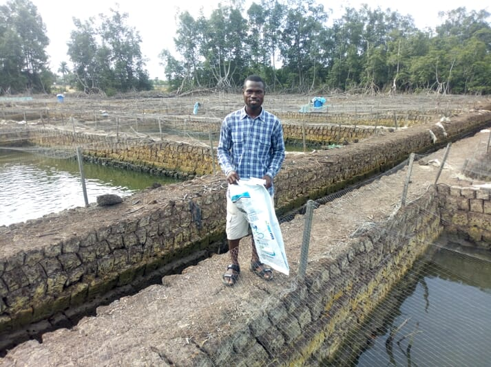 Emmanuel Agbelogode farms catfish in his earthen ponds at Egbokodo-Itsekiri fish cluster in the Niger Delta