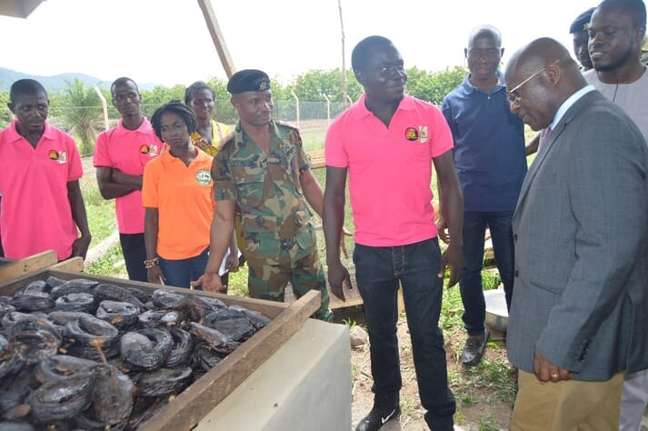 Captain Frimpong (in uniform) with the Majority Leader in Parliament, Osei Kyei Mensah-Bonsu, at one of the catfish smoking kilns