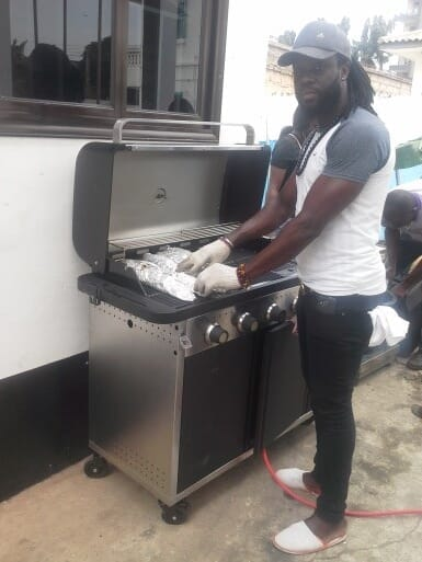 Buju, a grill master at one of Accra's burgeoning catfish joints