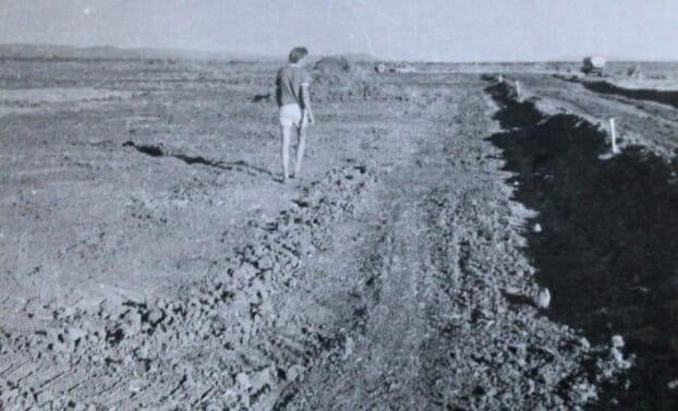 Fergus Flynn marking out fishponds, October 1981
