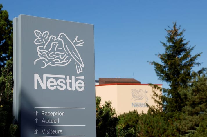Nestle logo in front of factory