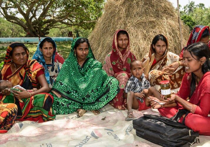 Field staff explaining the nutrition value of fish chutney in Sunamgunj, Bangladesh