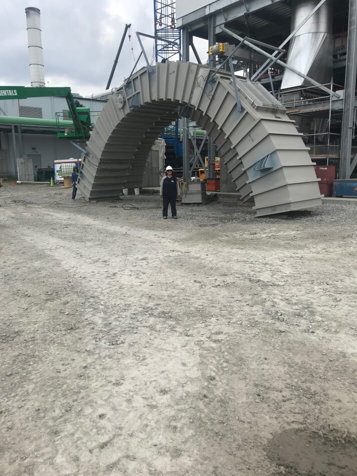 Emy Marroquin, health and safety manager at the Flint Hills Resources Fairmont ethanol plant, stands beside the top ring of the protein dryer before it is installed
