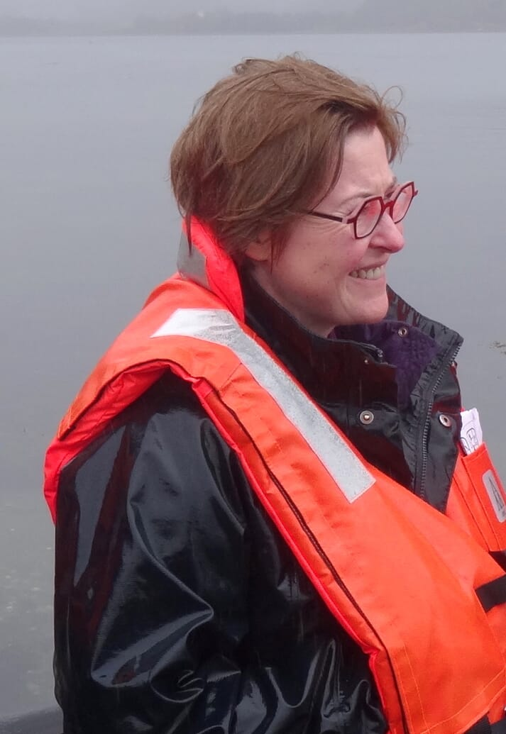 Heather visiting a salmon farm this spring