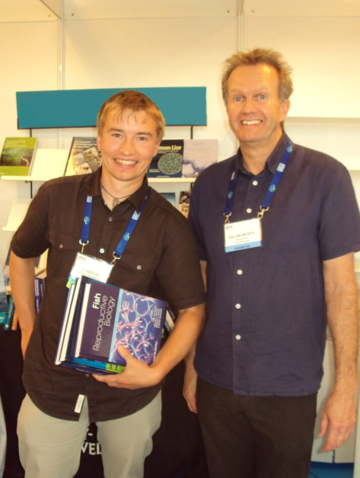 Jiri Kristan receives a book from Nigel Balmforth, 5m's Head of Publishing, as part of the Lindsay Laird Award at AE212 in Prague