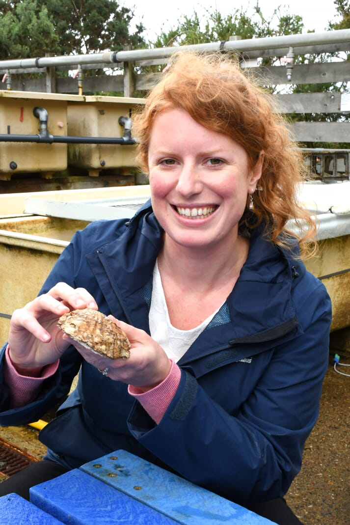Dr Mairi Cowan with a native oyster in the Alan Ansell research aquarium at SAMS