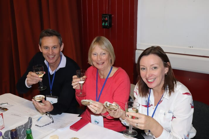 It's a tough job, but... Ben Wright, Nicki Holmyard and Elaine Jamieson sample Scotland's finest native oysters