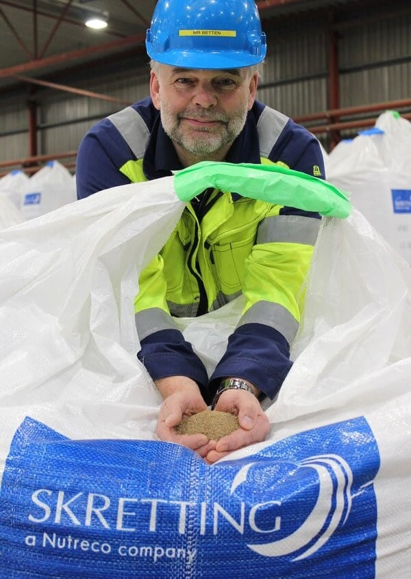 Magne Betten at Skretting Norway's factory at Averøy with the insect meal that was used for the first time in a commercial feed