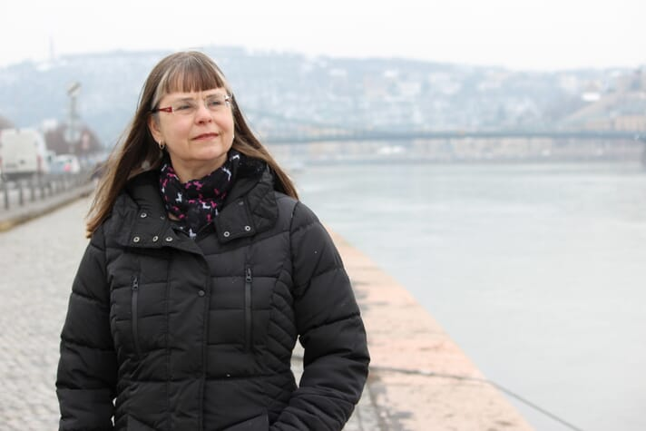 Victoria Chomo, who works as an economist with the FAO, beside the Danube