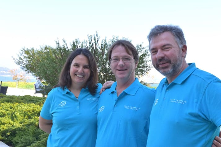Joana with her colleagues at BioMar: Jef Peeters (middle, product manager for shrimp hatcheries) and Chris Dinneweth (far right, hatchery business unit manager)