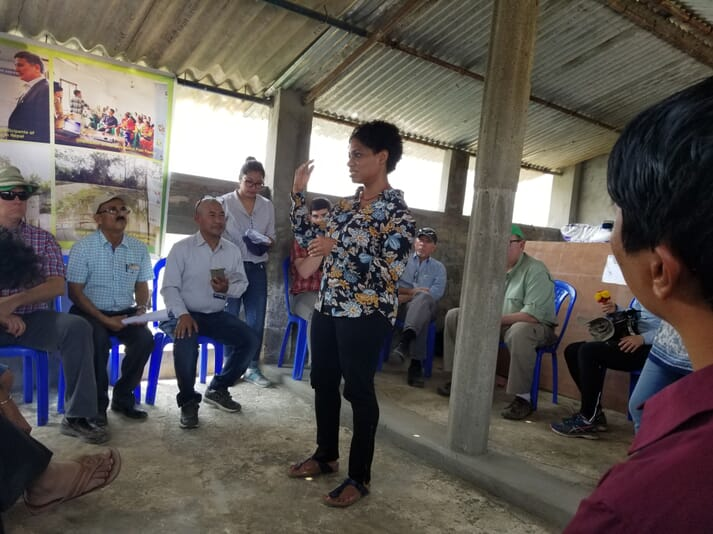 Dr Juli-Anne Royes Russo conducting an information session with carp farmers and the Winrock International Board of Directors, including Dr Vrigu Duwadi, in Nepal