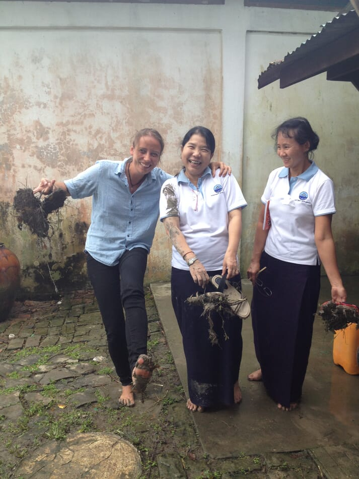 Kyra Hoevenaars (left) with fish farmers in Myanmar
