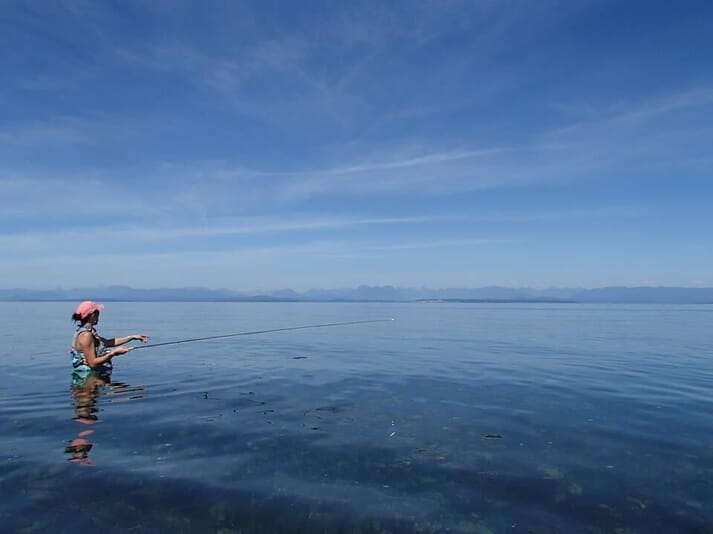 Dr Braden fly-fishing for sockeye and pink salmon in the waters off Vancouver Island