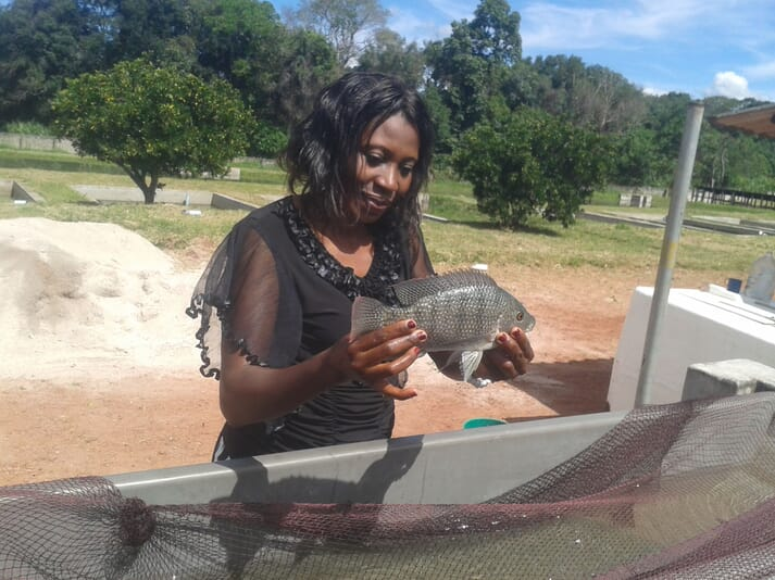 Dr Mary Lundeba with a tilapia brood fish