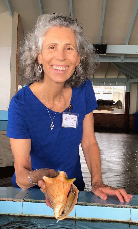 Dr Megan Davis with a queen conch