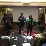 Shweta Vakil addressing her colleagues during a company meeting