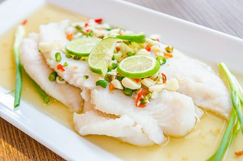 Cooked white fish on a plate